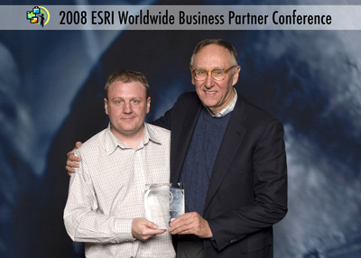 Scott Hutchinson, Marketing Manasger (left) accepts the 2008 ESRI New Business Partner of the Year Award on behalf of Symology. Presenting the award is Jack Dangermond, president and founder of ESRI.