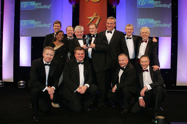 """The Team"" collecting the award"
